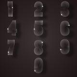 Стеклянные номера на серой предпосылке Стоковые Изображения RF