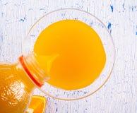 стеклянные померанцы померанца сока Стоковые Фото