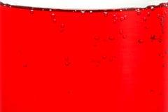 стеклянный жидкостный красный цвет Стоковое фото RF