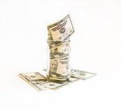 Стеклянный опарник при доллары проинвестированные в ем на банкнотах Стоковое фото RF