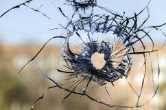 Стеклянный снимок предпосылки пулевого отверстия Стоковые Фото
