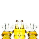4 стеклянных бутылки с дополнительным оливковым маслом Стоковые Изображения RF