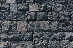 Стена базальта каменная стоковая фотография