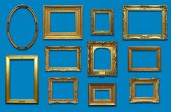 Стена галереи с рамками золота Стоковые Фотографии RF