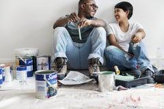Стена дома картины пар принимая пролом Стоковая Фотография