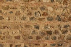 Стена камней и коричневых кирпичей абстрактная предпосылка Стоковая Фотография RF