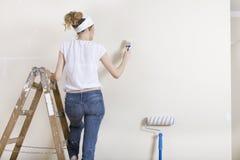 Стена картины женщины на лестнице Стоковое Изображение