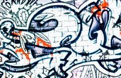 стена кирпича текстурированная надписью на стенах Стоковое Фото