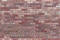 Стена краснокоричневого кирпича предпосылка текстурная Фасад  стоковое изображение rf