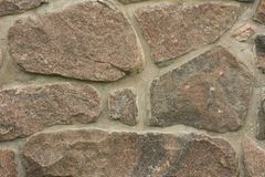 стена предпосылки текстурированная камнем гранит стоковая фотография