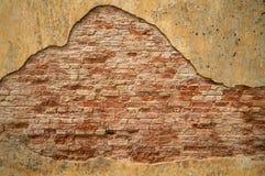 стена предпосылки треснутая кирпичом текстурированная Стоковое Изображение RF