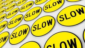 Стена предусматриванная в аккуратном массиве желтых медленных знаков Стоковые Фото