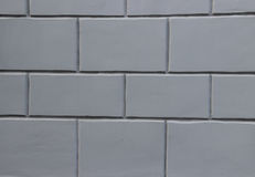 Стена сделанная из серых блоков Стоковая Фотография