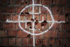 Стена с повреждением пули Стоковые Изображения