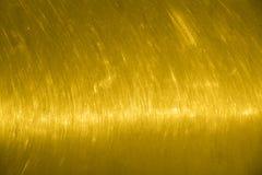 Стена текстуры золота Поцарапанная предпосылка желтого золота с пирофакелом горизонтально Стоковая Фотография RF