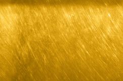 Стена текстуры золота Поцарапанная предпосылка желтого золота безшовная Стоковые Фото