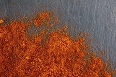 стена текстуры кирпича предпосылки старая Порошок перца красных чилей Взгляд сверху Стоковое фото RF