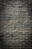стена темноты кирпича предпосылки Стоковое фото RF