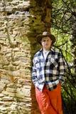 стена утеса шотландки человека померанцовая Стоковые Изображения RF