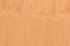 Стена цвета цемента Grunge оранжевая Стоковые Фото