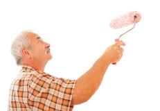 Стена человека крася белая Стоковое Изображение