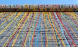 Стена Adobe с картиной капания Стоковое Изображение RF