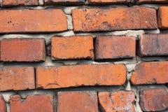 Стена Ld от красного кирпича Кирпич красной глины Кирпичная стена Старая кроша кирпичная стена Кирпичи и камни в старой стене Стоковая Фотография RF