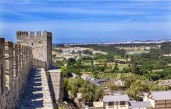 Стены Countrside Obidos Португалия башен башенок замка Стоковое Изображение