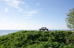 Стенд и таблица на взморье Стоковая Фотография RF