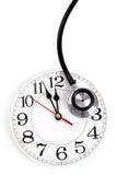 Стетоскоп и часы стоковая фотография rf