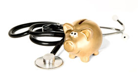 Стетоскоп медицины с золотистым деньг-box Стоковые Фото
