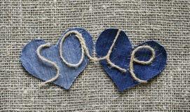 Стильная надпись от продажи шпагата в моей руке на 2 джинсовой ткани s Стоковая Фотография