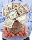 Стимул для бизнесмена - положите в мешки вполне банкнот доллара Стоковая Фотография RF