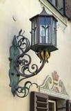 Стилизованная античная лампа на стене дома Стоковое Фото