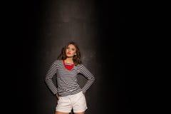 Стили моды pinup девушки на черной предпосылке Стоковые Фото