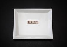 стильная квадратная керамическая плита при диета слова сделанная деревянных малых квадратов Стоковое Фото