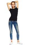 Стильная молодая женщина в вскользь ткани за белой предпосылкой Стоковые Фотографии RF