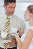 Стильные коллеги имея кофе совместно Стоковые Изображения RF