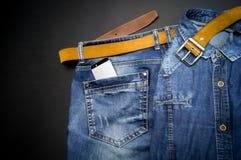 Стильные одежды на черной предпосылке Стоковые Фотографии RF
