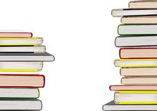 Стога книг изолированные на белой предпосылке Стоковые Фото
