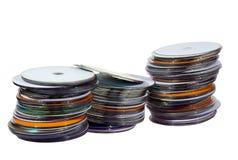 3 стога красочных компакт-дисков на белизне Стоковые Фотографии RF
