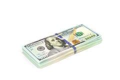 Стога долларов изолированных на белой предпосылке конец вверх Стоковое фото RF