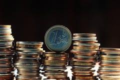 Стога долларов концепции монеток Стоковая Фотография