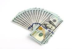 Стога долларов на белой предпосылке Стоковое Изображение