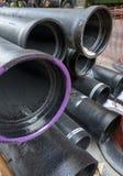 Стог большой черной трубы водопровода стоковое изображение rf