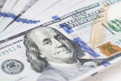 Стог денег в долларах США внутри получает внутри 100 долларовых банкнот наличными Стоковое Изображение