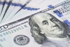 Стог денег в долларах США внутри получает внутри 100 долларовых банкнот наличными Стоковые Изображения RF