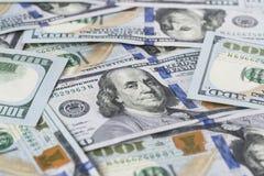 Стог денег в долларах США внутри получает внутри 100 долларовых банкнот наличными Стоковое фото RF