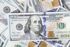 Стог денег в долларах США внутри получает внутри 100 долларовых банкнот наличными Стоковое Фото