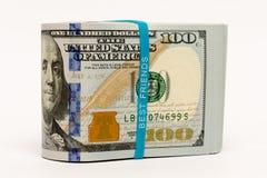 Стог денег в банкнотах наличных денег долларов США Стоковая Фотография RF